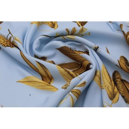 Нежно голубая плательная ткань с оригинальным принтом