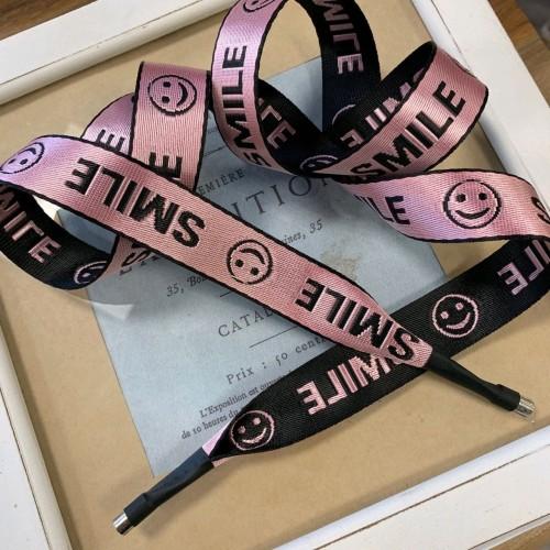 Шнурок декоративный из репсовой жаккардовые розовой ленты с текстом