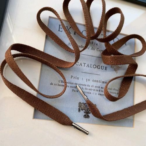 Шнурки трикотажные коричневого цвета с золотистым люрексом