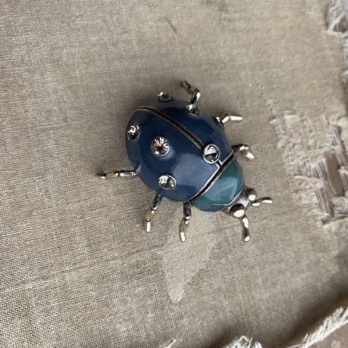 Брошь жук серебристый с синей эмалью и стразами