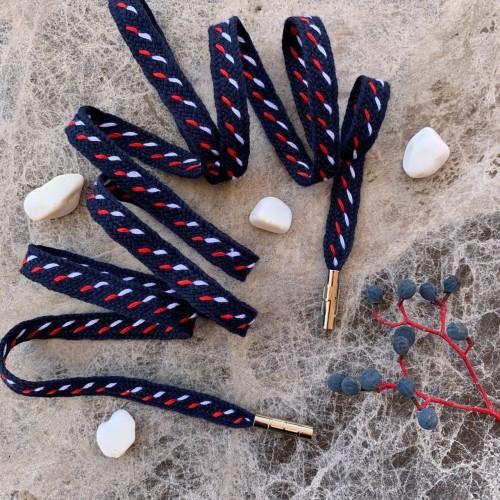 Темно-синие плетёные шнурки с красно-белым декором