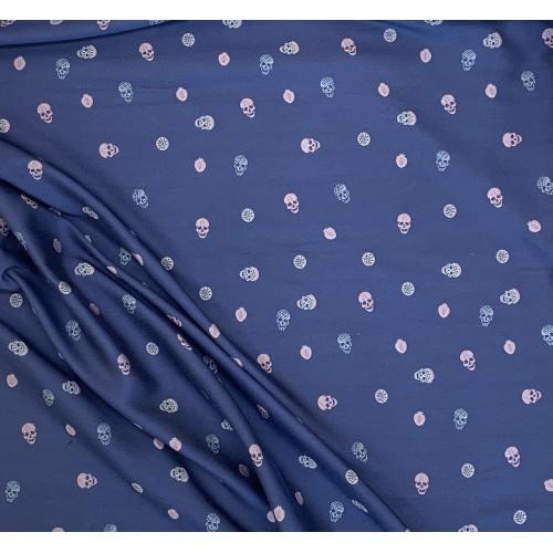 Ткань жаккаровая синего цвета с розовыми и серыми черепами по всему полотну